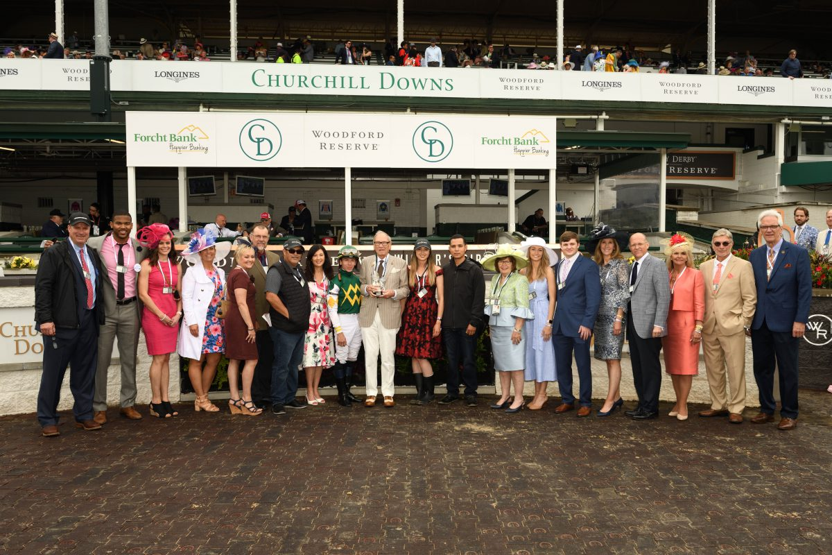 Forcht Bank: group of people posing for the camera with a jockey