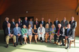 Hall of Fame: group of people sitting and standing smiling at the camear
